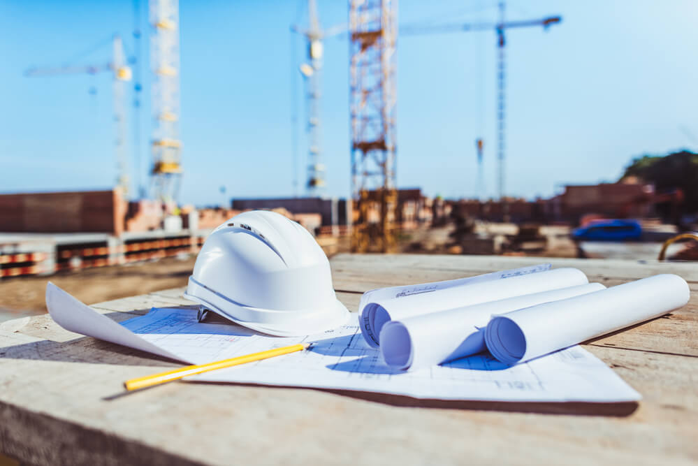white hard hat with paperwork