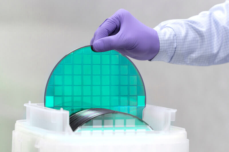 silicon Wafer with semiconductors in plastic white storage box takes out inside clean room